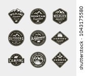 set of vintage wilderness logos.... | Shutterstock .eps vector #1043175580