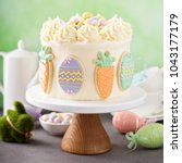 carrot cake with cream cheese... | Shutterstock . vector #1043177179