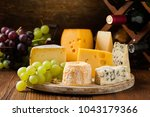 mix cheese on wooden board with ...   Shutterstock . vector #1043179366