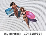 summer fun. top view of two... | Shutterstock . vector #1043189914