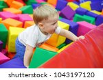 baby on trampoline. child in... | Shutterstock . vector #1043197120