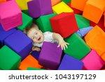baby on trampoline. child in... | Shutterstock . vector #1043197129