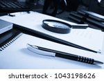 office desk table with supplies.... | Shutterstock . vector #1043198626