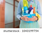 woman with cleaning equipment... | Shutterstock . vector #1043199754