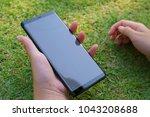 female hand holding the... | Shutterstock . vector #1043208688