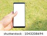 female hand holding the... | Shutterstock . vector #1043208694