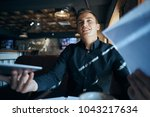 business man with documents ...   Shutterstock . vector #1043217634