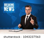 television presenter in front... | Shutterstock . vector #1043237563