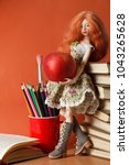 beautiful doll with an apple... | Shutterstock . vector #1043265628