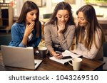 group of girls making a pause... | Shutterstock . vector #1043269510