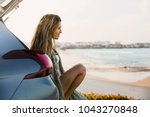 beautiful woman sitting in the... | Shutterstock . vector #1043270848