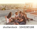 group of young people sitting... | Shutterstock . vector #1043285188