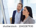 young businesswoman standing... | Shutterstock . vector #1043287930
