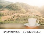 coffee espresso on wood table... | Shutterstock . vector #1043289160
