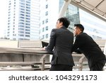 two business man standing and... | Shutterstock . vector #1043291173