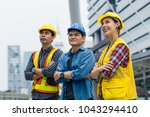 group of engineer peoples pose... | Shutterstock . vector #1043294410