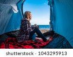 beautiful blonde woman sitting...   Shutterstock . vector #1043295913