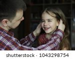 adult father looking with love... | Shutterstock . vector #1043298754