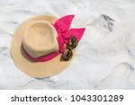 straw hat with pink ribbon bow... | Shutterstock . vector #1043301289