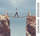 man rope passing over a bridge... | Shutterstock . vector #1043311318