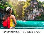 traveler aian woman relaxing on ... | Shutterstock . vector #1043314720