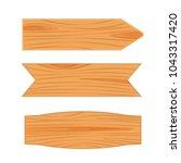 flat design of wooden road sign.... | Shutterstock .eps vector #1043317420