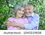 happy couple hugging in spring... | Shutterstock . vector #1043319838