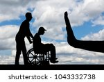 silhouette of sad disabled man... | Shutterstock . vector #1043332738
