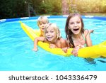 young friends in the garden pool | Shutterstock . vector #1043336479