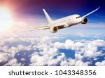 commercial airplane flying... | Shutterstock . vector #1043348356