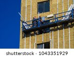 facing the building with a... | Shutterstock . vector #1043351929