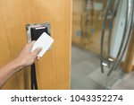 close up hand using a card for... | Shutterstock . vector #1043352274