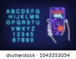 casino online neon sign.... | Shutterstock .eps vector #1043353054