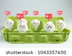 happy eggs with many likes  one ... | Shutterstock . vector #1043357650
