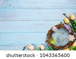 Easter Nest And Tulips On A...