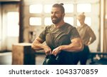 fit young man in sportswear... | Shutterstock . vector #1043370859