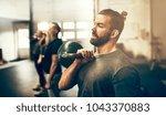 fit young man in sportswear... | Shutterstock . vector #1043370883