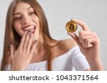 focus on golden bitcoin as main ... | Shutterstock . vector #1043371564