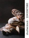 variety of loafs fresh baked... | Shutterstock . vector #1043387080