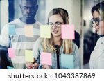 focused group of diverse young... | Shutterstock . vector #1043387869