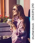 cheerful woman in the street...   Shutterstock . vector #1043391190