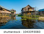 wooden floating houses on inle... | Shutterstock . vector #1043393083