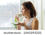 mature woman drinks morning...   Shutterstock . vector #1043393320