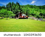 summer traditional wooden house ... | Shutterstock . vector #1043393650