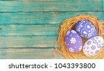 colorful easter egg in the nest   Shutterstock . vector #1043393800