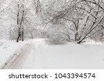 heavy snowfall in moscow. snow... | Shutterstock . vector #1043394574