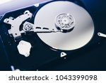 disassembled hard drive from... | Shutterstock . vector #1043399098