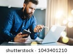 young bearded businessman is... | Shutterstock . vector #1043401210