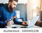 young bearded businessman works ... | Shutterstock . vector #1043401228