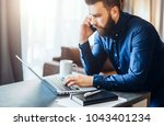 young bearded businessman is... | Shutterstock . vector #1043401234